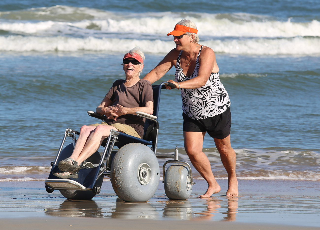 Beach mobility rentals and manufacturing home for Motorized beach wheelchair rental